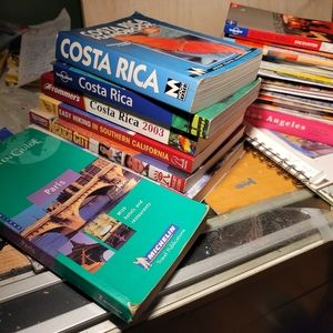 Lot of travel guide books & maps